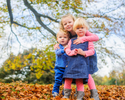 Cousins in the autumn leaves in Lake District