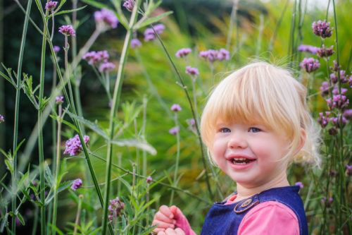 Smiles in photo session in flowers in Cumbria