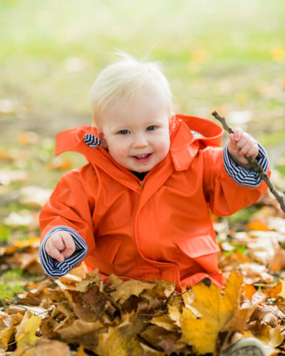 In leaf pile -baby photographs in Cumbria