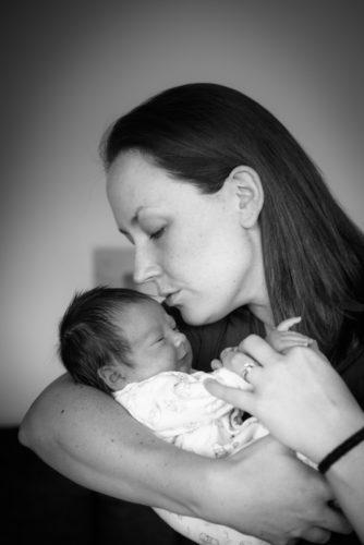 Kisses from Mum in newborn photo shoot in Carlisle