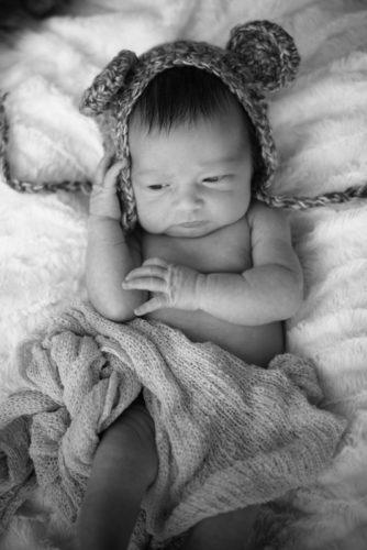 Adorable newborn Abby posing