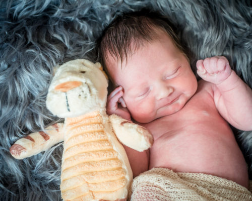 Newborn Abby and her Tigger toy