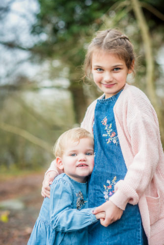 Cuddles for sister - Cockermouth baby photographers