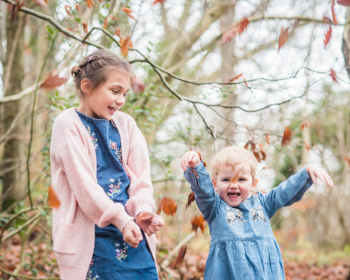 Sisters throwing leaves, Lake District photographers