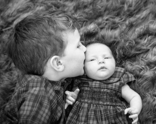 Kisses for his sister, newborn photographer Cockermouth