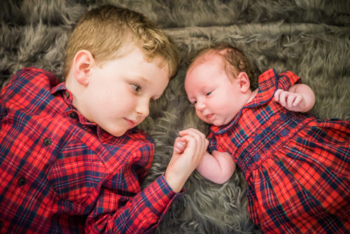 Betsy and Milo holding hands - newborn photographers Keswick
