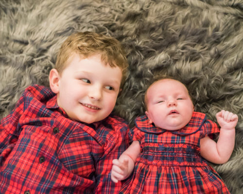 Betsy and brother Milo in matching outfits - lifestyle newborn photographers