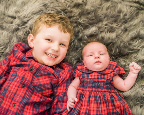 Milo and Betsy smiling, newborn photographers Cumbria