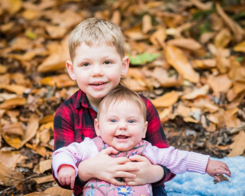 Brother and sister cuddles Carlisle family photographer