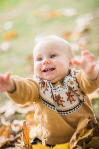Smiling baby Pearl in the autumn park - Carlisle baby photographers