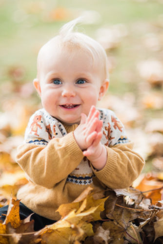 Clapping baby in the Autumn sunshine - Lake District