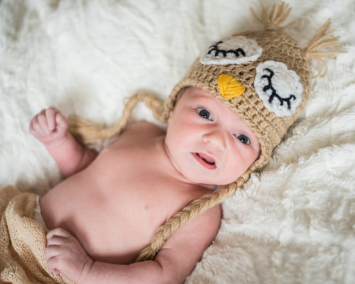 Baby Nova in owl hat, newborn photographers Cumbria