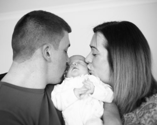 Kisses with parents - baby photographer Aspatria