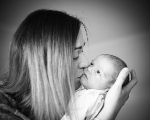 Mum kissing Nova - baby photography Cumbria
