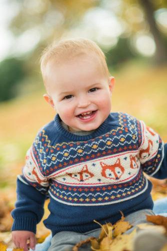 Smiling Ethan on Autumn family portraits Cumbria