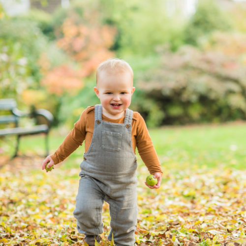 Ethan running in leaves - Keswick family photographers
