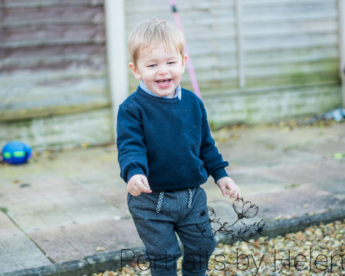 Miles playing in garden, Cumbria baby photographers