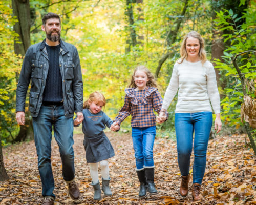 Family walk in woods, baby photographer Cumbria