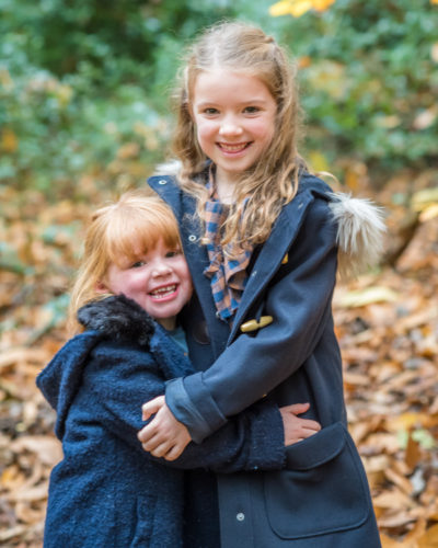 Sisters cuddle, Autumn portraits Lake District