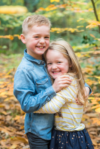 Brother and sister cuddles - family photographers cumbria