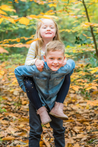Piggyback for sister - Cumbria baby photographers