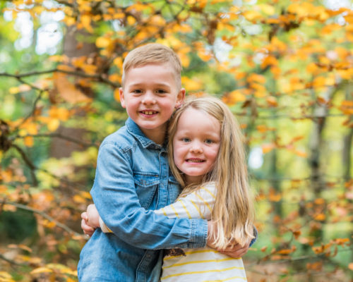 Sibling cuddles - woodland photo session Cumbria
