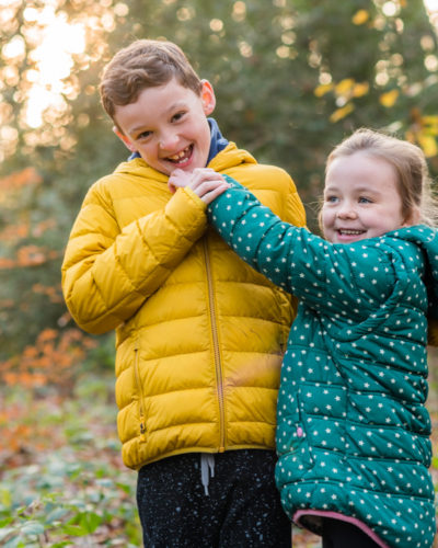 Tickling her brother, Lake District family photographers