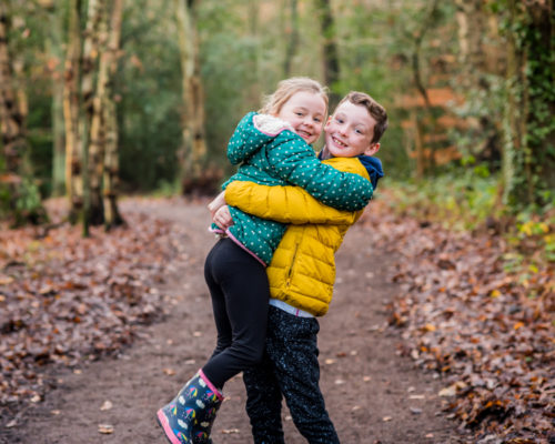 Brother and sister cuddling, childrens photography Cumbria
