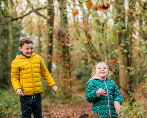 Throwing leaves, baby photographer Keswick