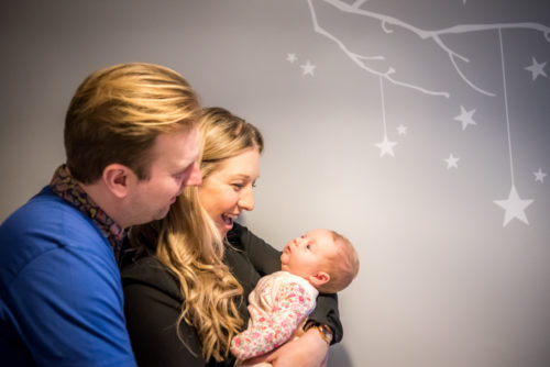 Cuddles in baby's nursery, baby photographer Cumbria