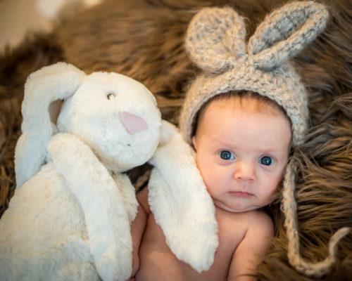 baby in rabbit hat with toy, baby photographer Maryport