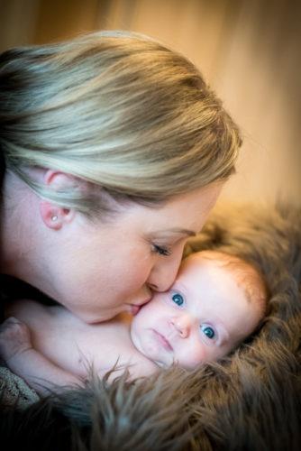 Mum kissing baby, newborn photographer Cockermouth