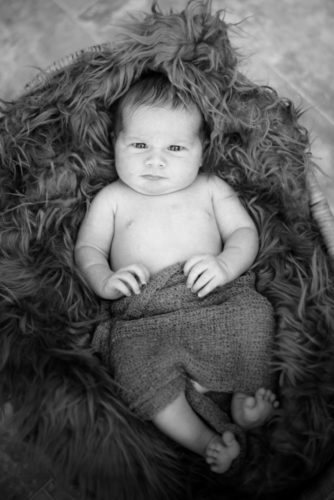 Baby Ramsey in basket, newborn photographers Aspatria