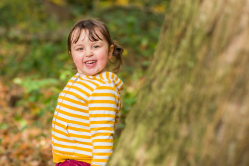 Felicity hiding behind tree, Workington baby photographers