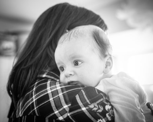 Henry resting on Mum's shoulder, baby photographers Carlisle