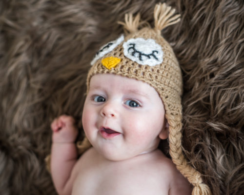 Smiling Henry in owl hat, newborn photographers Wigton
