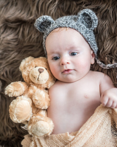Henry in hat with ears with his teddy, baby photographers Cumbria