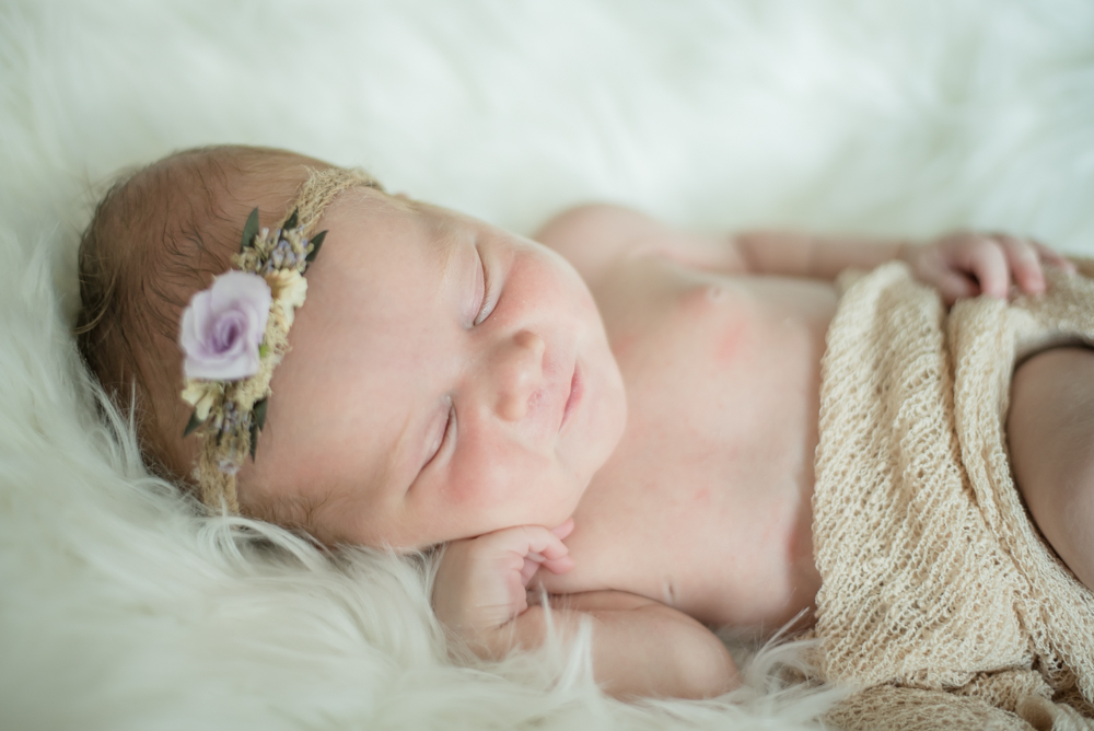 Sleepy baby posing, newborn photographer Cumbria