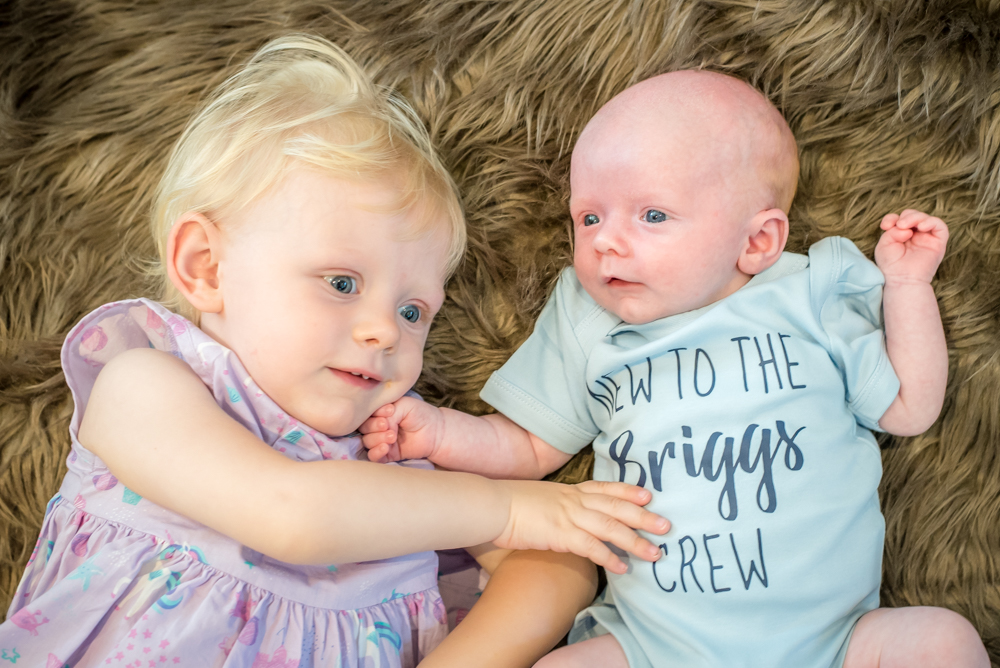 Cuddles with his sister, newborn portraits Aspatria