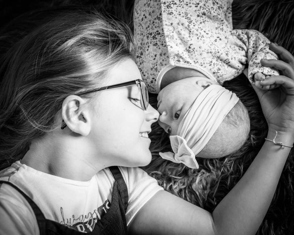 Touching noses with sister, baby portraits Workington