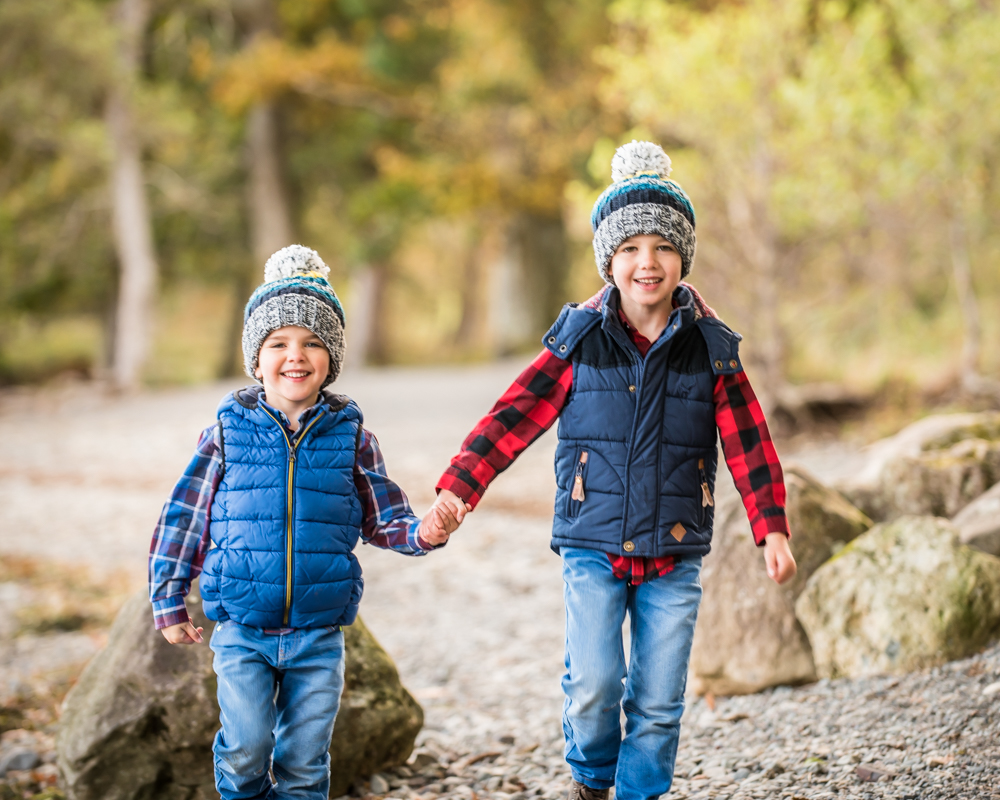 Brothers running together by lake, Carlisle family photographers