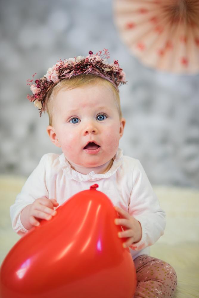Baby looking at camera, newborn photographer Maryport