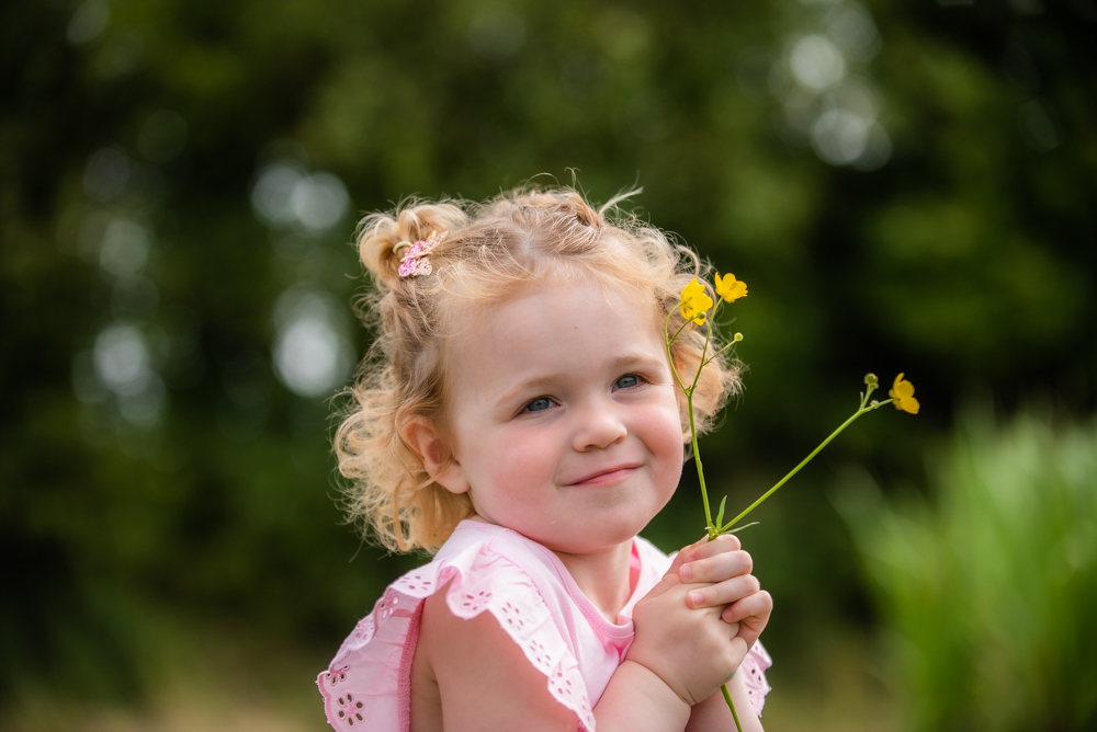 Evie holding flowers in Fletchertown Cumbria