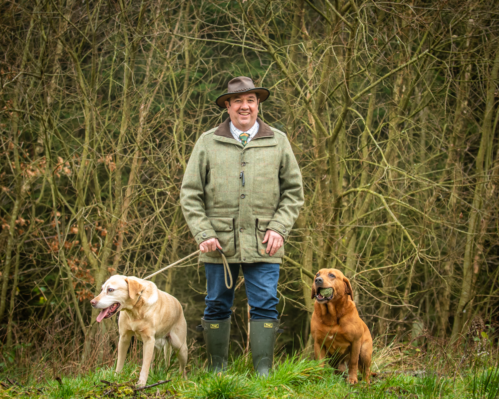 Dogs posing with their owner in Low Moor woods, Lake District