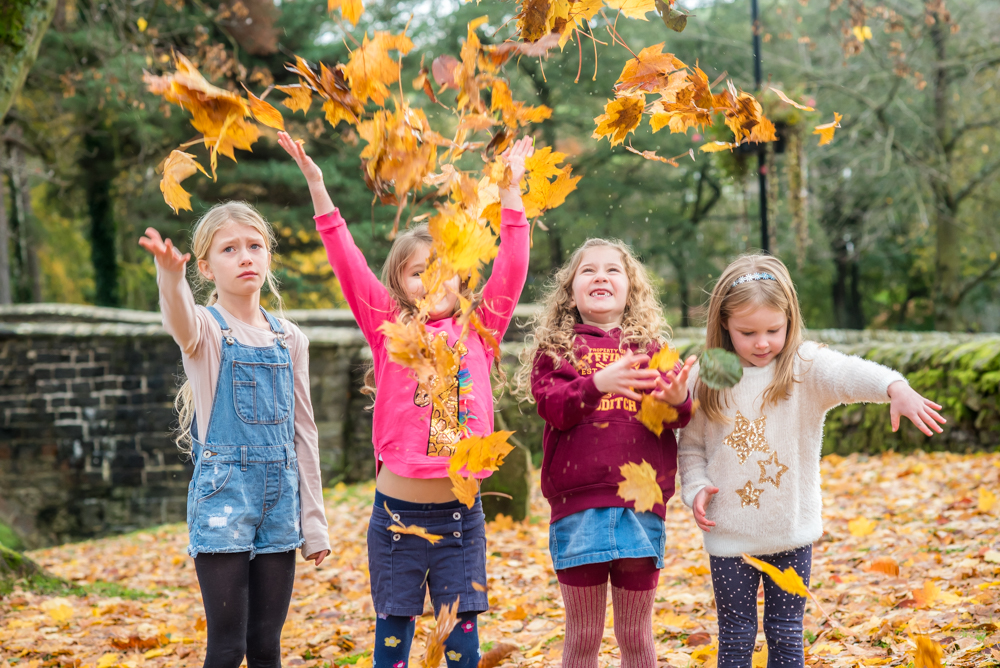 Cousins throwing leaves in Bradfield village