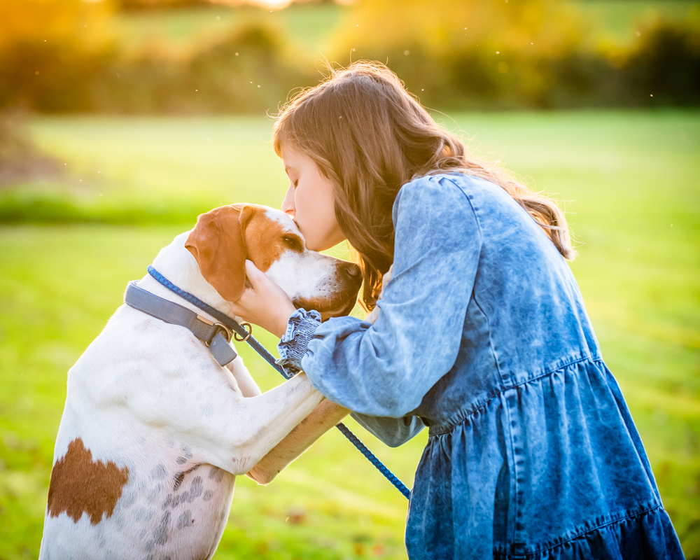 Girl kissing her pet dog, pet portraits, sunset fletchertown