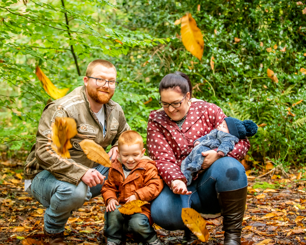 Family portrait with leaf throwing in Ecclesall Woods